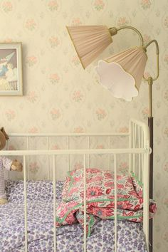 Beautiful, feminine room for baby. Esp love the gorgeous lamp. #baby #decor #nursery