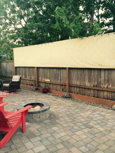 Privacy Screen Made From Outdoor Fabric, 2x4s, And A Staple Gun.