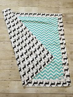 This blanket is handmade and a perfect for gift giving or for your own little one. It is a generous size, measuring approximately 34x34. Made of black and white silhouette deer print with blue and white chevron, making it perfect for a little girl or boy! This blanket is large enough to easily swaddle your baby when theyre a newborn. Its also great for putting on the floor for tummy time or a car seat cover.  Made of 100% Flannel Cotton. Double layer for warmth and top stitched for…