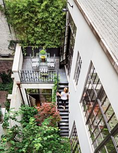 The house's footprint fills the lot, but there's still plenty of green space. A terrace adjacent to the breakfast room provides access to the courtyard garden on the first floor.    Photo: Scott Frances/©2013 www.scottfrances.com