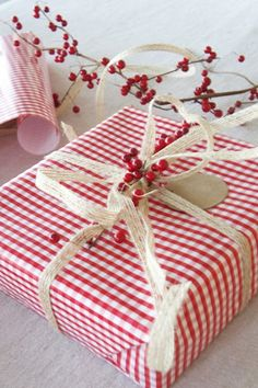 Gift wrapping ideas for the holidays!!! Bebe'!!! Like the gingham check paper!!!