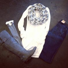 gray boots, lace-trimmed leg warmers, chevron scarf, long white sweater, denim.