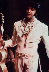 White pearl aka On Stage suit (first 'jumpsuit' worn after the karate and two piece suit on 1/26/1970) aka Cossack Suit
