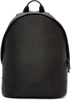 Grained leather backpack in black. Carry handle at top. Adjustable shoulder straps featuring textile bands in multicolored stripes. Leather logo patch at face. Two-way zip closure at main compartment. Laptop compartment and zip pocket at bag interior. Fully lined. Tonal stitching. Approx. 10