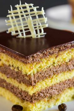 Opera cake is a classic French dessert that is notorious for its decadent layers of almond sponge cake, chocolate-coffee cream, and gorgeous ganache glaze. It is truly a masterpiece of a cake! Easy No Bake Desserts, Great Desserts, Delicious Desserts, Dessert Recipes, Breakfast Recipes, Yummy Food, Easy Opera Cake Recipe, Perfect Cake Recipe, Moroccan Desserts