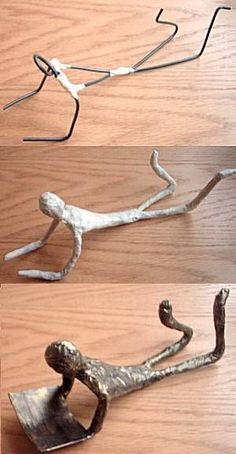 Giacometti figures made from wire, masking tape and paint : nice book end
