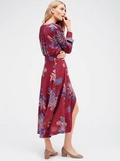Miranda Midi Dress | Pretty printed midi dress featuring front button closures and front tassled tie accents. Beautiful embroidery along the shoulders and front slits create a femme look. Cute front pocket detail. Half lined.