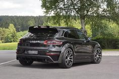 Stunning Black Mansory Porsche Macan Poses