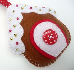 Gingerbread House Felt Ornament - retail from UK shop Devonly Crafts; no pattern, but lots of lovely felt Christmas felt ornaments for sale for inspiration Домик, Новый год, Рождество, елочные игрушки Christmas Makes, Noel Christmas, Handmade Christmas, Christmas Projects, Felt Crafts, Christmas Crafts, Felt Christmas Decorations, Felt Christmas Ornaments, Hanging Decorations