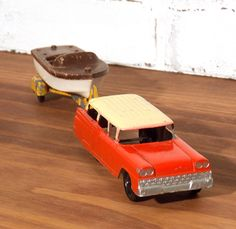 Vintage Tootsietoy Ford Stationwagon and Chris-Craft Boat on Trailer Toy by j3decor on Etsy https://www.etsy.com/listing/243630400/vintage-tootsietoy-ford-stationwagon-and
