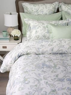a beautifully elegent design in calming greens with a hint of blue expertly woven in gray