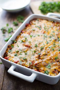 thinking of trying to make this for dinner tomorrow night & maybe adding chicken.Healthy Mexican Casserole has roasted corn, roasted bell peppers, cheese, enchilada sauce, and corn tortillas. 230 calories of delicious. Mexican Dishes, Mexican Food Recipes, Vegetarian Recipes, Dinner Recipes, Cooking Recipes, Healthy Recipes, Mexican Corn, Vegetarian Mexican, Casseroles Healthy