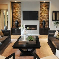 Stone on inset walls flanking fireplace with storage for television components. Note the lighting and detail.
