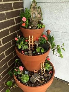 Fairy garden with various flowering plants and succulents. Nice for the porch!