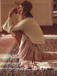 Love the soft pink ruffle maxi skirt paired with the chunky cream pulloverand tan felt hat … so cool | all pieces from Free People~ x debra  Dust Jacket on Bloglovin'