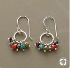 Earrings Handmade Colorful stones from around the world convene in a playful cluster: gaspeite, sugilite, coral, garnet and turquoise. Handmade in USA with Thai silver hoops and French wires.