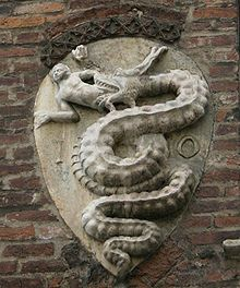Coat of arms, the biscione  (basilisk) of the House of Visconti, on the Archbishops' palace in Piazza Duomo, Milan. The arms bear the initials IO.[HANNES] of Archbishop Giovanni Visconti (1342-1354