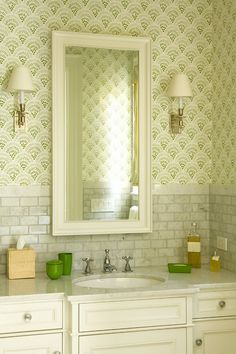 Green patterned wallpaper with matching green cups and soap dish