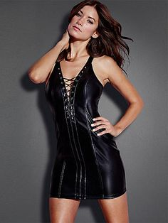 The Paloma Lace-Up Dress - The club dress goes cutting-edge in sleek, faux leather with racy lace-up. Glam features include:  <ul>    <li>Curve-conforming pleather fabric</li>    <li>Body-con silhouette</li>    <li>Sexy strappy back and zipper</li>    <li>Polyester</li>    <li>Imported</li> </ul> A strappy black platform takes your sex appeal over the top.