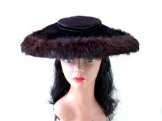 Black Fur 40s 50s Saucer Hat - Black Velvet and Rabbit Fur Wide Brim Hat - Viva Las Vegas  from Om Again Vintage    https://www.etsy.com/listing/196876759/killer-black-fur-40s-50s-saucer-hat?ref=shop_home_active_1