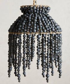 🌟Tante S!fr@ loves this📌🌟Hand-Beaded Vara Chandelier. Hand-strung wooden beads on jute strands swing freely from this aysmmetrical chandelier. Multiple sizes via anthropologie Beaded Chandelier, Chandelier Pendant Lights, Chandelier Ideas, Chandelier Creative, Wire Basket Chandelier, Pendant Lamp, Diy Luminaire, I Love Lamp, Style Deco
