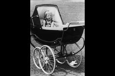 1963, a 2-year-old Diana Frances Spencer sits in her pram at Park House, the estate where she grew up in Sandringham, Norfolk. The future princess was born at home on July 1, 1961, the daughter of Johnnie Spencer, Viscount Althorp, and Frances Ruth Burke Roche. Diana's parents had wed at Westminster Abbey in a big society wedding. They later divorced.