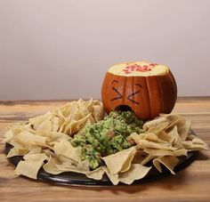 Guacamole and queso dip! Put a bowl inside the pumpkin and fill it with queso .