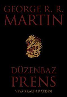 """George R. R. Martin Düzenbaz Prens Veya Kral'ın Kardeşi """"Düzenbaz Prens"""", Buz ve Ateşin Şarkısı serisinin ilk kitabı olan Taht Oyunları'ndan yaklaşık olarak 200 yıl öncesinde geçen ve Ejderhaların Dansı olarak bilinen Targaryen iç savaşının sebeplerini kısa, kısa olmasına rağmen açık ve keskin bir dille anlatan, ''Prenses ve Kraliçe'' hikayesinin karanlık yerlerine ışık tutan bir hikaye!Buz ve Ateş'in evreninde Westeros'un çalkantılı topraklarında geçen bu hikaye bizi; bütün dünyayı savaşa…"""