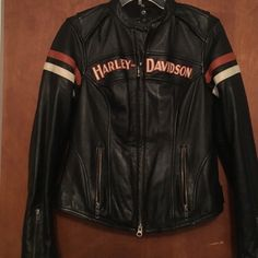 Leather Jacket The perfect woman's Harley jacket.  Leather, lots of pockets and vent zippers for warmer days. Harley-Davidson Jackets & Coats