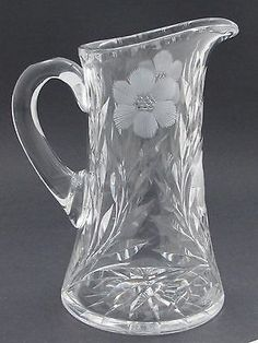 "Up for auction is this cut glass pitcher It is 9"" high by 5.5"" in diameter at base and weighs 4.255 lbs It is in good condition free of any chips cracks or cloudiness. Handle is free of heat cracks. I"