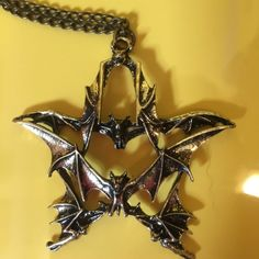 COOL Retro Bat Necklace is Unisex. Very detailed. Great to gift or use for yourself!  Very goth hippy chic retro cool necklace. Creates that double takelook. Cute well made, unique, unusual, standout piece of jewelry  Fashion Jewelry  Material - Alloy  Color - Gold Jewelry Necklaces