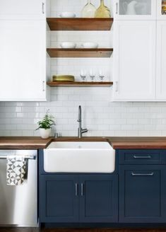 navy lower + white upper cabinets