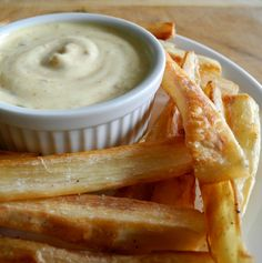 Crispy Baked Yuca Fries - Peeled and sliced yuca is boiled, tossed in coconut oil and salt, and then baked into crispy fries.