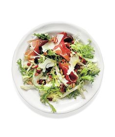 Frisée and Endive Salad With Dates, Parmesan, Almonds, and Prosciutto: Packed with fruit, nuts, cheese, and meat, this satisfying salad can stand alone as a meal.