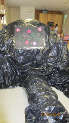 Geology birthday party!Cover a dome tent and tunnel in garbage bags. Spray paint gravel gold and have kids take turns going in the mine to mine for gold. Alternatively get tumbled stones or other treats. Kids LOVED this activity at my daughters birthday.