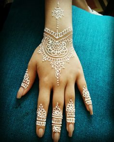 Shades of Arts by Vidya  Henna design using white henna.