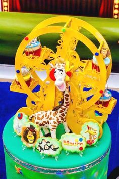 Check out this fun Madagascar-themed circus birthday party! The cupcakes in the ferris wheel are awesome! See more party ideas and share yours at CatchMyParty.com #catchmyparty  #circuscaupcakes #partyideas #madagascar #circusparty