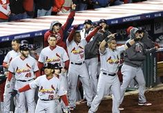 Members of the St. Louis Cardinals react after Pete Kozma batted in David Freese and Daniel Descalso on a single in the ninth inning of Game 5 of the National League division baseball series against the Washington Nationals early Saturday, Oct 13, 2012, in Washington