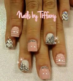 This is a luxorious nails design. One white nail is decorated with some gems. Others two are pink and last two are silver with white waves.: