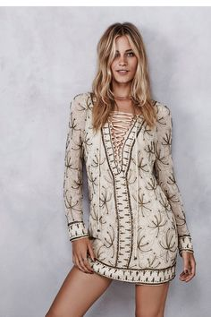 Sicily Beaded Mini   Allover embellished and embroidered shift mini dress featuring adjustable lace-up detailing on the bust. Subtle V-neckline. Lined.