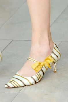 """@Tory Burch the yellow bow on kitten heels with yellow & subtle black stripes is a  shoe all women would be crazy for with a stripe bow & Mary Jane style looks like they were made for """"The Great Gatsby"""""""