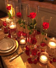 Schneider's Florist #receptionflowers by SpringfieldOhioFlorist.com with #roses #gold #greenery. #candles #cylinders #red #centerpiece #floatingcandles #weddingflowers #springfieldohio #wedding #flowers #springfieldohiowedding #ohiowedding #ido #engaged