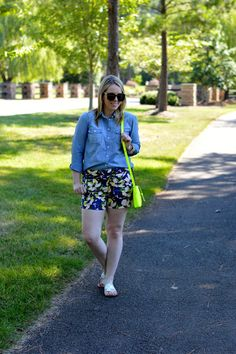 Chambray shirt and floral shorts outfit.