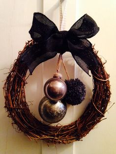 DIY Industrial Chic Wreath - £3 twig wreath from Hobbycraft, baubles and black wired ribbon from Wilko £1.50 each, add a home-made Pom Pom and voilà - £7 in total!