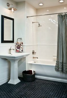 Guest bath.  This is pretty much perfect.  Love the white subway tiles with the black hex tiles.  Also love the subtle chair rail detail that is continuous throughout the room.  Great pedestal sink, cute curtain to soften things up.