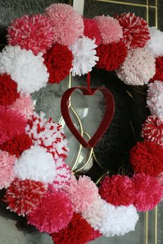 home.made.: Valentine's Pom Pom Wreath @ http://home---made.blogspot.com/2011/01/valentines-pom-pom-wreath.html
