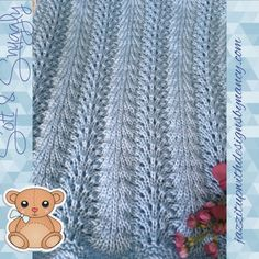 Beautiful baby blanket in soft blue handknit in feather and fan pattern
