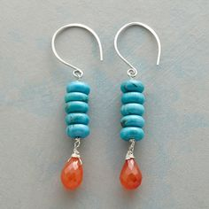 "DESERT BRIGHTS EARRINGS -- Swinging from oversized French wires on our exclusive earrings, bright turquoise wheels strike a brilliant contrast to fiery carnelian drops. Handmade in USA with sterling silver. 2-1/4""L."
