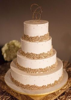 Sparkling gold pearl cake. Photo by John Christopher Photographs. #wedding #cake #gold
