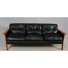 Swedish Black Leather Sofa | feather-filled, solid rosewood arms. A perfect piece of furniture.